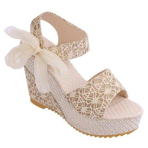 Trendy Embossing and Bowknot Design Wedge Heel Women's Sandals